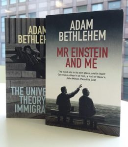 Mr Einstein and Me and The Universal Theory of Immigration books on display in front of a window