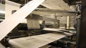 Printed web paper passing through a printing press