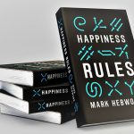 Happiness Rules books displayed on a table