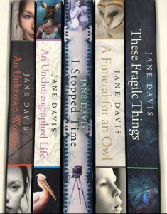 Books by Jane Davis with spines displayed